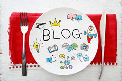 Blog concept on white plate with fork and knife Royalty Free Stock Photography