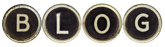 Blog dans de vieilles clés de machine à écrire Photographie stock libre de droits