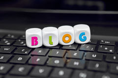 Blog about everything. Letter dice on black keyboard with blog text Royalty Free Stock Photography