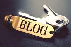 Blog geschrieben auf goldenen Schlüsselring Stockfotografie