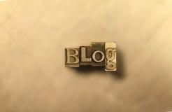 Blog - golden lettering. Golden blog lettering sign on brown background Royalty Free Stock Image