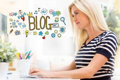 Blog with happy young woman in front of the computer. Blog with happy young woman sitting at her desk in front of the computer Royalty Free Stock Image