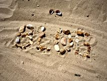 Blog letters on the beach. Blog inscription on the sand. Summer beach blog concept Royalty Free Stock Photography