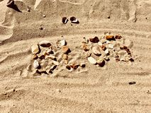 Blog letters on the beach. Blog inscription on the sand. Summer beach blog concept Royalty Free Stock Images