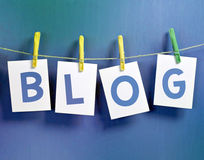 Blog. Letters on laundry hook on blue grunge background Stock Photo