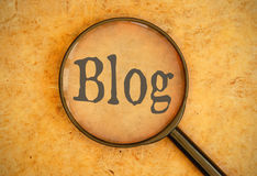 Blog. Magnifying glass focused on the word blog Stock Photos