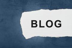 Blog mit Weißbuchrissen Stockfotografie