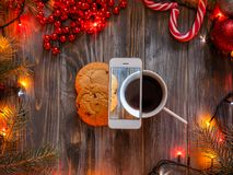 Blog mobile photo christmas decor phone cup cookie. Blogging and mobile photography concept. christmas and new year festive decor on wooden background, fairy stock photo