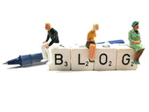 Blog and pen. The word blog with pen and figurines Stock Photos
