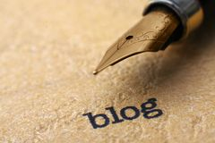 Blog and pen. Close up of Blog and pen Royalty Free Stock Images