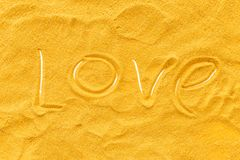 Blog or presentation background with yellow sand texture and love text top view.  stock photos