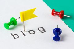 Blog push pin. Flag push pin on paper at blog word Royalty Free Stock Photography