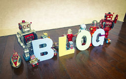 Blog robots. The word   BLOG on wooden floor with reto robots Stock Photo