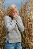 Blog style fashion photo of cute blond woman on corn field in late autumn royalty free stock image