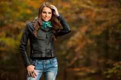 Blog style pretty young woman on a walk in forest on late autumn Royalty Free Stock Photos