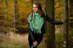 Blog style pretty young woman on a walk in forest on late autumn Stock Photos