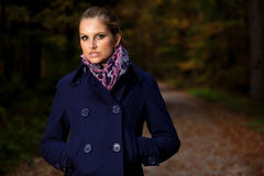 Blog style pretty young woman on a walk in forest on late autumn Stock Images