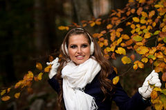 Blog style pretty young woman on a walk in forest on late autumn Stock Photo