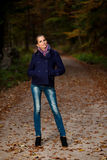Blog style pretty young woman on a walk in forest on late autumn Royalty Free Stock Photography