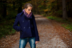 Blog style pretty young woman on a walk in forest on late autumn Stock Image
