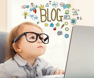 Blog text with toddler girl. Using her laptop Stock Image