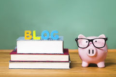 Blog theme with pink piggy bank with chalkboard Stock Photography