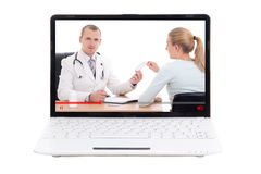 Blog visuel au sujet de la médecine - ordinateur portable avec le docteur et le patient sur le Sc Image libre de droits