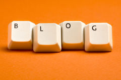 Blog-weiße Tasten auf Orange Lizenzfreie Stockfotos