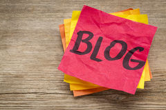 Blog word on a sticky note Royalty Free Stock Images