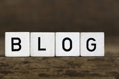 Blog. The word blog written in cubes on wooden background Stock Photos