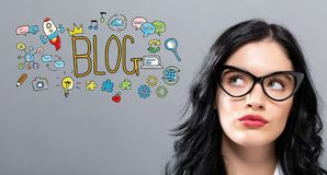 Blog with young businesswoman. In a thoughtful face Stock Photography
