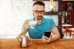 Blogger in cafe royalty free stock photography