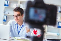 The blogger doing webcast on canadian immigration to canada. Blogger doing webcast on canadian immigration to Canada stock photos
