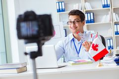 The blogger doing webcast on canadian immigration to canada. Blogger doing webcast on canadian immigration to Canada stock photography
