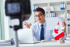 The blogger doing webcast on canadian immigration to canada. Blogger doing webcast on canadian immigration to Canada royalty free stock images