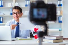 The blogger doing webcast on canadian immigration to canada. Blogger doing webcast on canadian immigration to Canada stock images