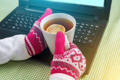 Blogger, freelancer, background picture of the winter season laptop, gloves, hot drinks. Blogger, freelancer, background picture of the winter season - laptop Royalty Free Stock Photos