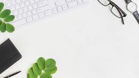 Blogger or freelancer workspace with notebook and green leaves. On light background royalty free stock images