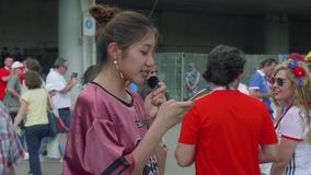 MOSCOW - CIRCA JULY, 2018: Blogger makes video reports about football fans before match metween national teams of Spain