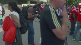 MOSCOW - CIRCA JULY, 2018: Blogger make video reports about football fans before match metween national teams of Spain