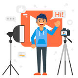 Blogger man that records video blog. Vector flat style illustration of happy blogger man that records video blog. Vlog concept Stock Photography