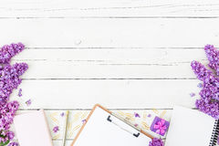 Free Blogger Or Freelancer Workspace With Clipboard, Notebook, Pen, Lilac, Box And Petals On Wooden Background. Flat Lay, Top View. Bea Royalty Free Stock Photo - 92967955
