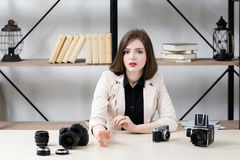 Blogger reasoning about photo equipment Stock Photo