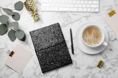 Blogger`s workplace with notebook, keyboard and coffee on marble table. Flat lay stock photos