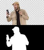 Blogger in trench with recording video on his phone while walking, Alpha Channel royalty free stock photos