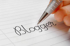 Blogger word handwriting royalty free stock photo