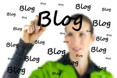 Blogger writing - Blog - on a virtual interface Stock Photos
