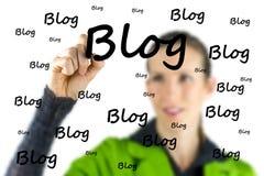 Blogger writing - Blog - on a virtual interface Stock Photos