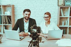 Bloggers makes a video about a business