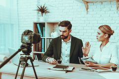 Bloggers makes a video about a business stock image